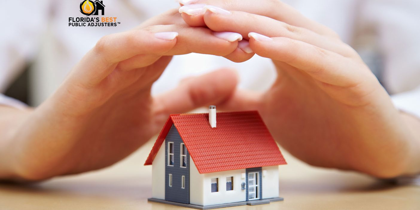 Hands covering home symbolic image