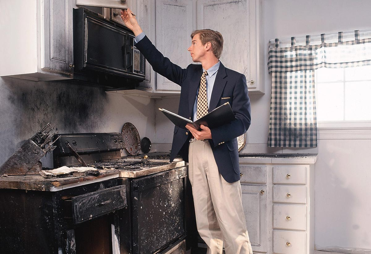 Public Adjuster inspecting kitchen fire damage