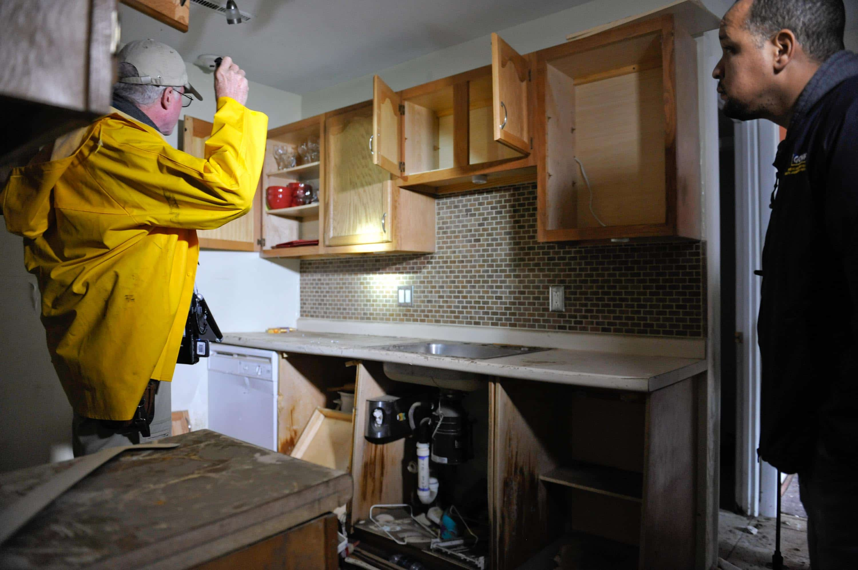 Fort Myers public adjuster inspecting kitchen