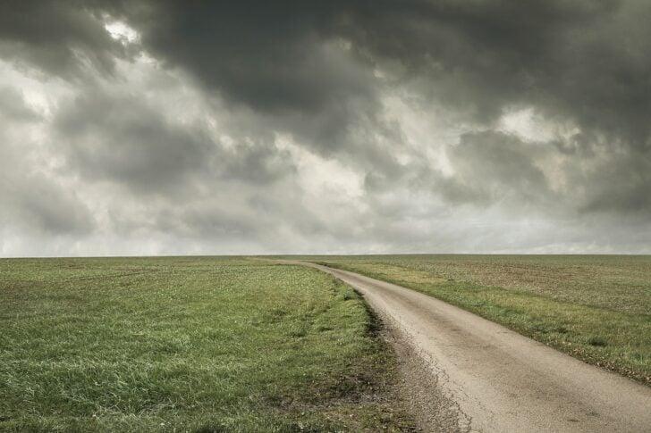stormy sky non descript rural road